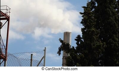 Smokestack of industrial building producing smoke. Chimney...