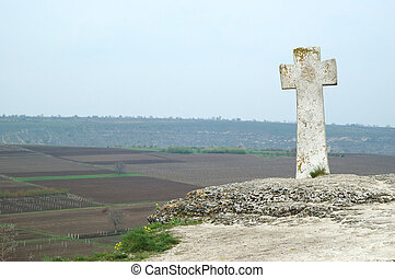 Old stone moldavian orthodox cross in Orhei,Moldova. Orhei -...