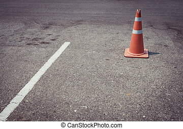 parking lot with traffic cone on street used warning sign on...
