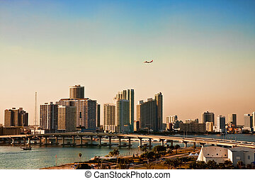 Airplane Flying Over Biscayne Bay and Miami - An airplane...