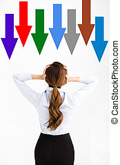 Rear View of stress businessWoman watching all arrow down
