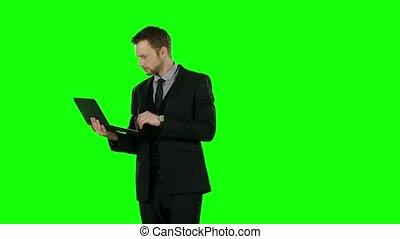 Business man using computer. Green screen. - Business man...