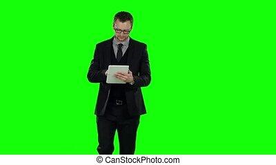 Business man makes online shopping . Green screen. -...