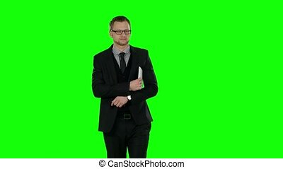 Business man makes online shopping. Green screen. - Business...