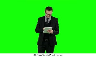 Business man use laptop and makes online shopping. Green...