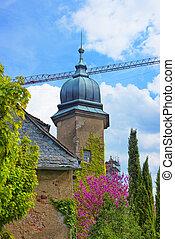 Spire of New Castle in Baden-Baden Baden-Baden is a spa town...
