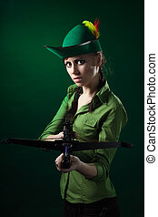 Serious woman with crossbow - Serious woman frowning holding...