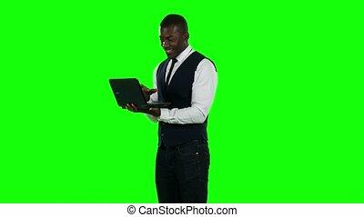 Businessman using laptop. Broker. Green screen. -...