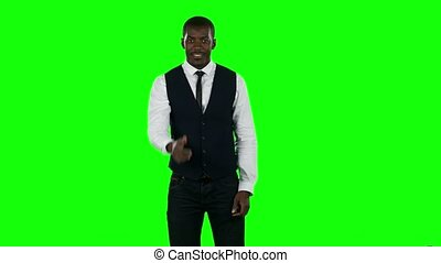 Businessman showing a thumbs up sign. Green screen -...
