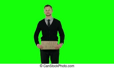 Businessman with a cardboard sign that asks about desire to find a job. Green screen