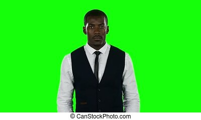 Businessman wearing a suit hold a cardboard sign that asks about desire to find a job. Green screen