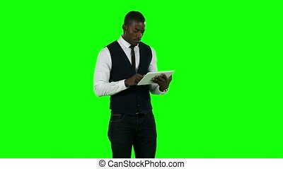 Businessman using digital tablet pc. Green screen -...