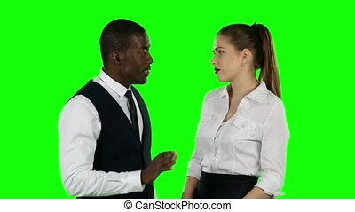 Businessman arguing with businesswoman. Over white...