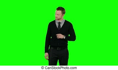 Businessman holding his head. Green screen