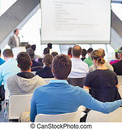 Male speeker having talk at public event. - Presentation in...