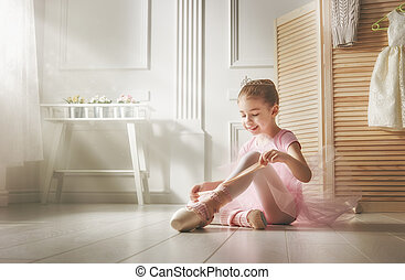 girl in a pink tutu - Cute little girl dreams of becoming a...
