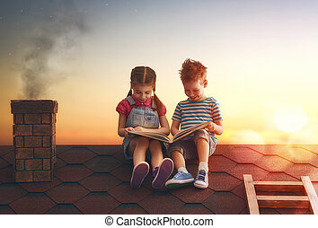 Children reading a book sitting on the roof of the house....