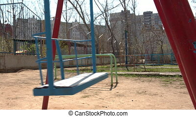 swing in play ground - empty blue swing in play ground
