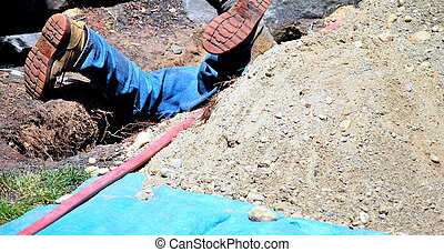 Male utility repairman. - Male utility worker repairing a...