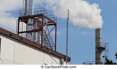 Smokestack Producing Smoke - Smokestack of industrial...