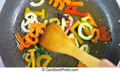 Stir-frying mixed alphabet letters vegetables
