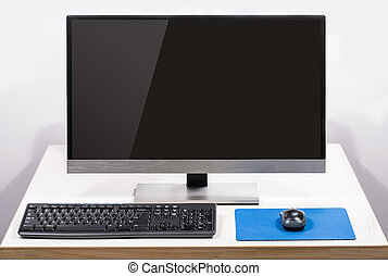 desktop computer with screen glare isolated on white