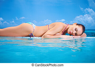 Woman at Maldives - Beautiful woman resting near pool at...