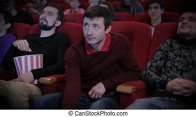 Young man pirating at the cinema - Man pirating at the...