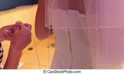 tightening corset bride - bride to tie the corset wedding...