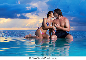 Copile at Maldives - Romantic couple sitting next to...