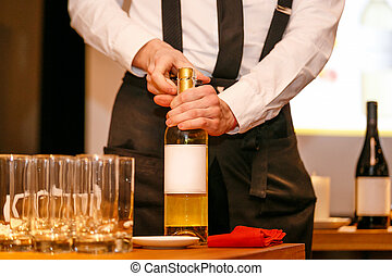 Opening of a wine bottle with corkscrew - Opening process of...