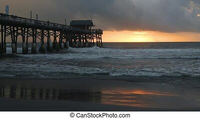 Florida Pier at Sunrise Loop - The rising sun burns a band...