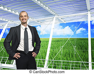 green eco business - green grass field and blue cloudy sky...