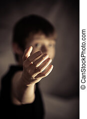 Obscured person with beckoning gesture - Obscured young male...