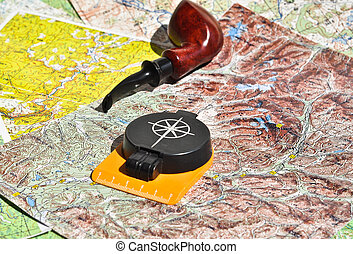 Map, compass and pipe Smoking area. The indispensable...