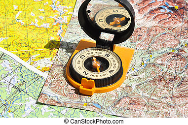 Compass lies on a topographic map. Compass on the map - this...