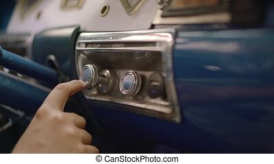 Young Boy In Vintage Car Touches Buttons And Controls -...