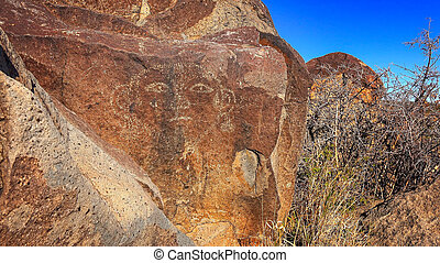 Face Petroglyph at Three Rivers Petroglyph site in New...