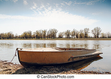Boat at the riverside - Old fishing boat at the river side