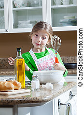 girl on kitchen - view of young beautiful girl cooking at...