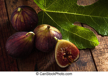 figs - close up view of fresh figs on color back