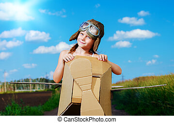 sky dream - Little dreamer girl playing with a cardboard...