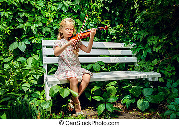 ringtone - Pretty little girl playing the violin at a summer...