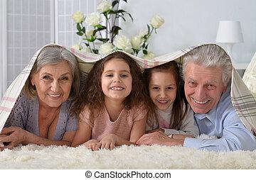 Happy senior couple with grandchildren