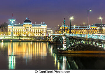 Lyon University bridge along Rhone river at night