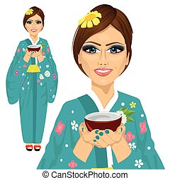 Japanese pretty woman wearing kimono holding a cup of green tea
