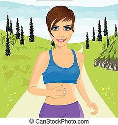 young happy woman jogging outdoors in park
