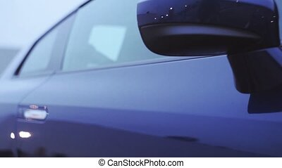 View of front mirror of dark blue new car. Presentation. Showing. Automobile. Cold shades