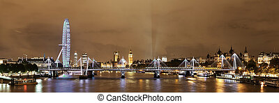 Thames River night with London urban architecture
