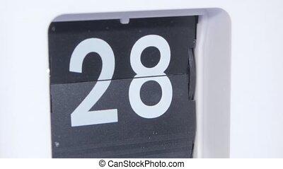Flip-clock. Close up - Flip clock, retro flip style clock,...